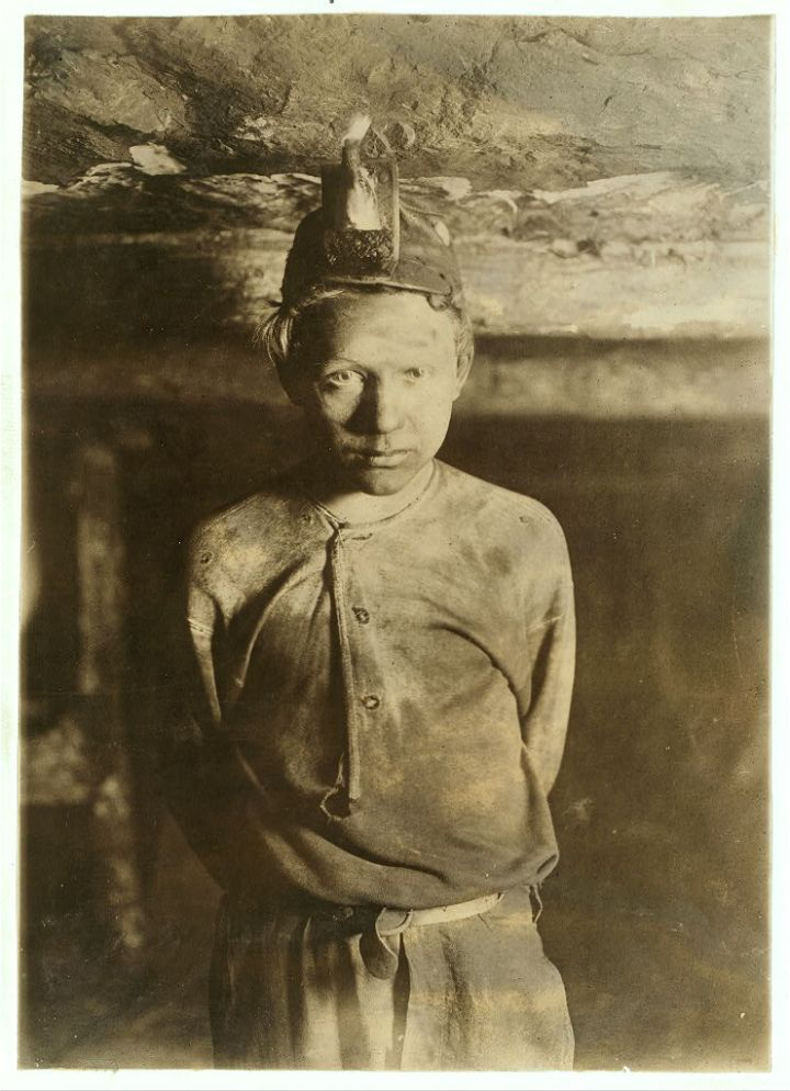 Trapper Boy, Turkey Knob Mine, Macdonald, W. Va. Boy had to stoop on account of low roof, photo taken more than a mile inside the mine. Witness E.N. Clopper. Location: MacDonald, West Virginia