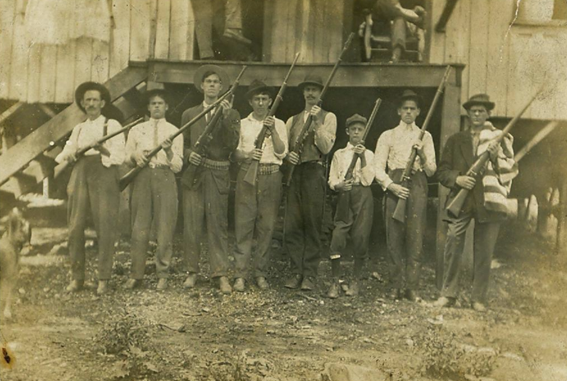 Miners posing with their guns in Eskdale, West Virginia during the Paint--Cabin Creek strike from 1912-1913.