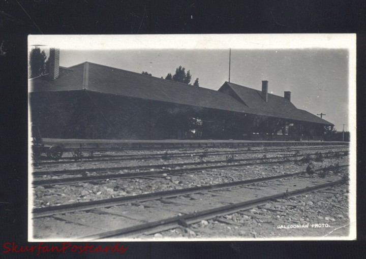 Black and white image of a railroad station